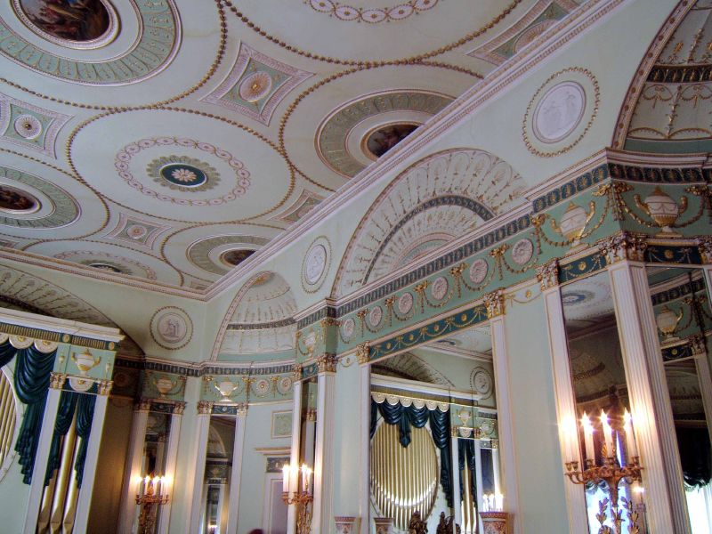 Classical/Neo Classical interior with ornate ceilings.