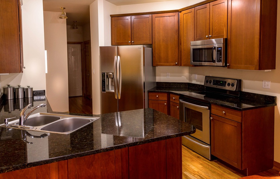 Ever wonder why there are so many stainless steel appliances in modern kitchens? Photo of kitchen with stainless steel appliances.