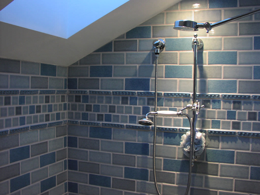 master bathroom -Photo of Newly-Remodeled Master Bathroom with with dual shower heads and blue subway tile