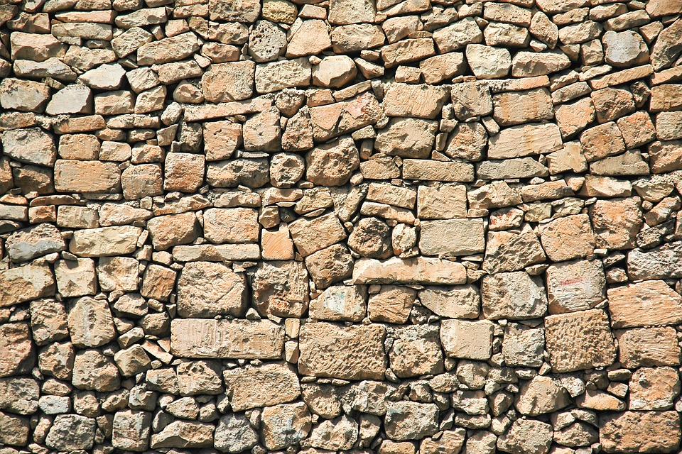 adding stone on a concrete wall