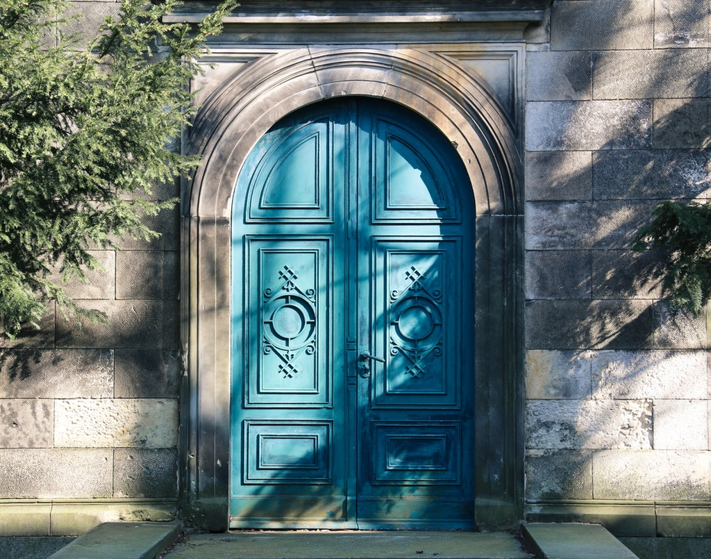 blue front door with arch architecture