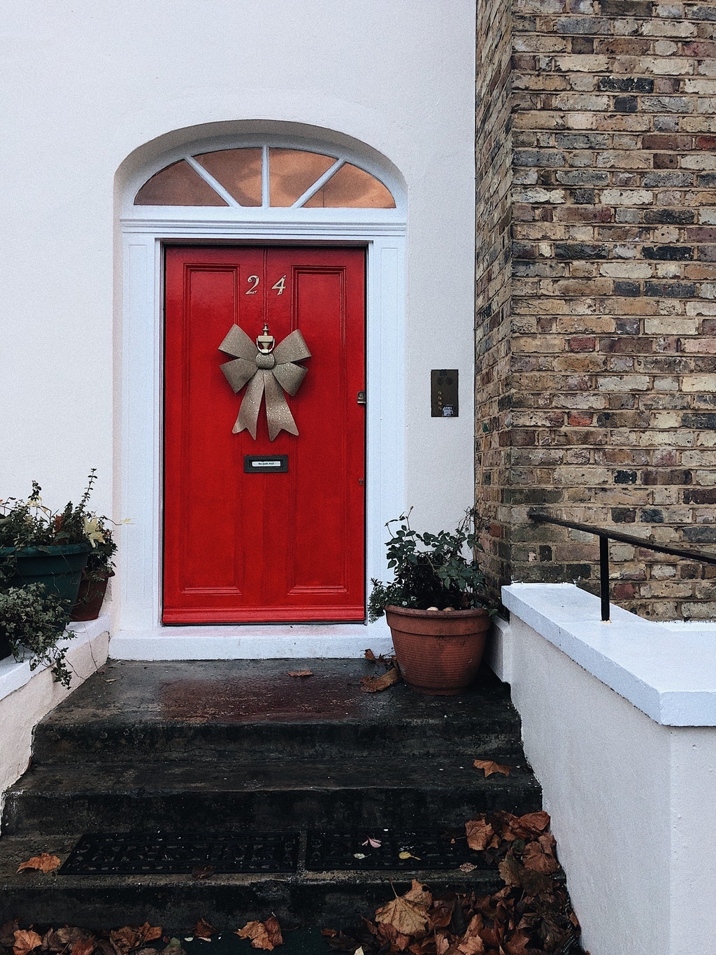 red front door with stairs