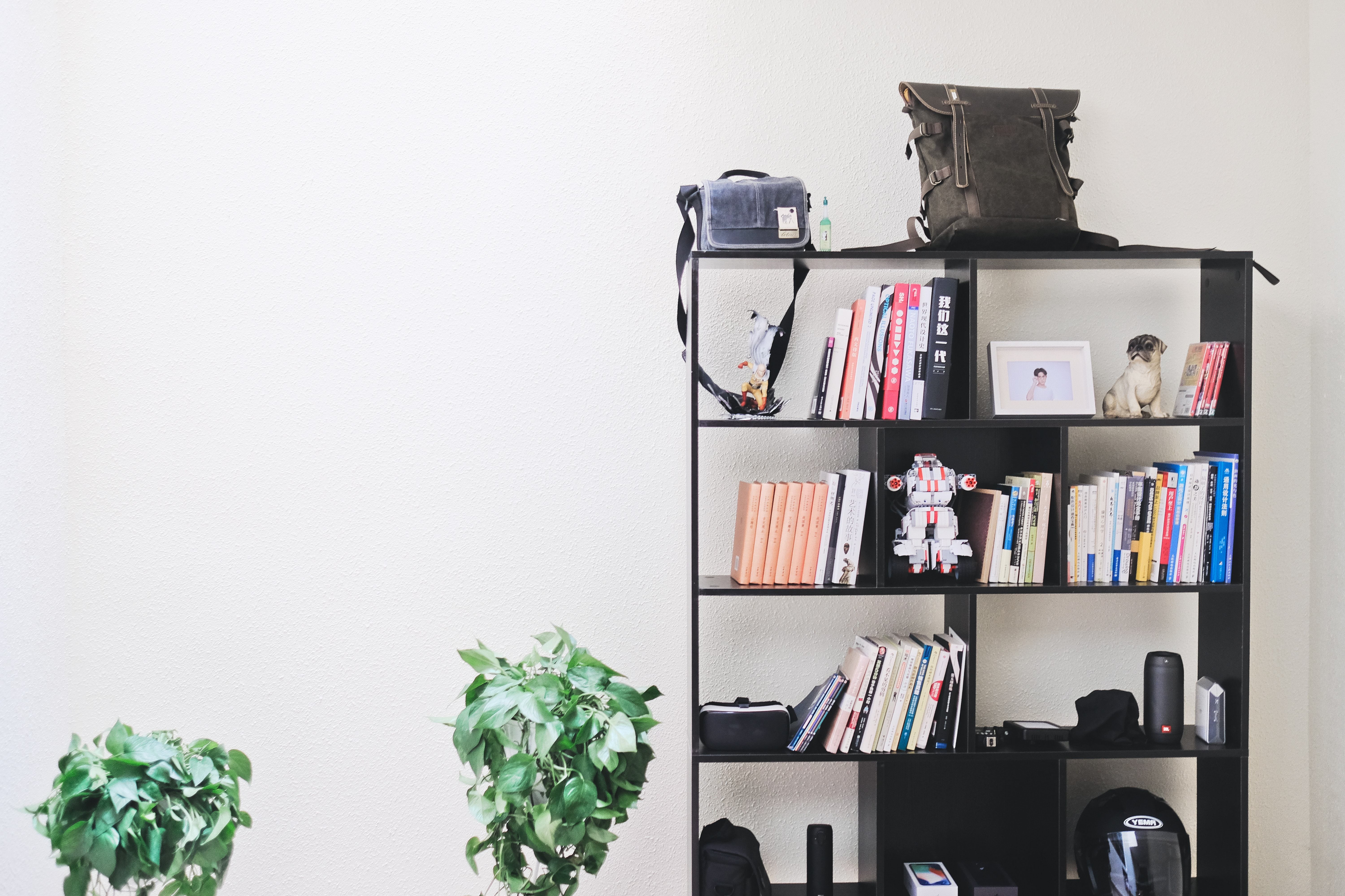 Books, bags and other things on a shelf