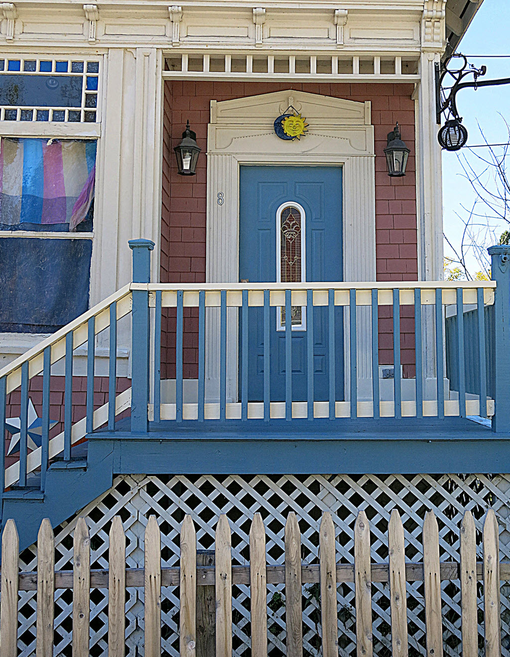 blue front door with stairs