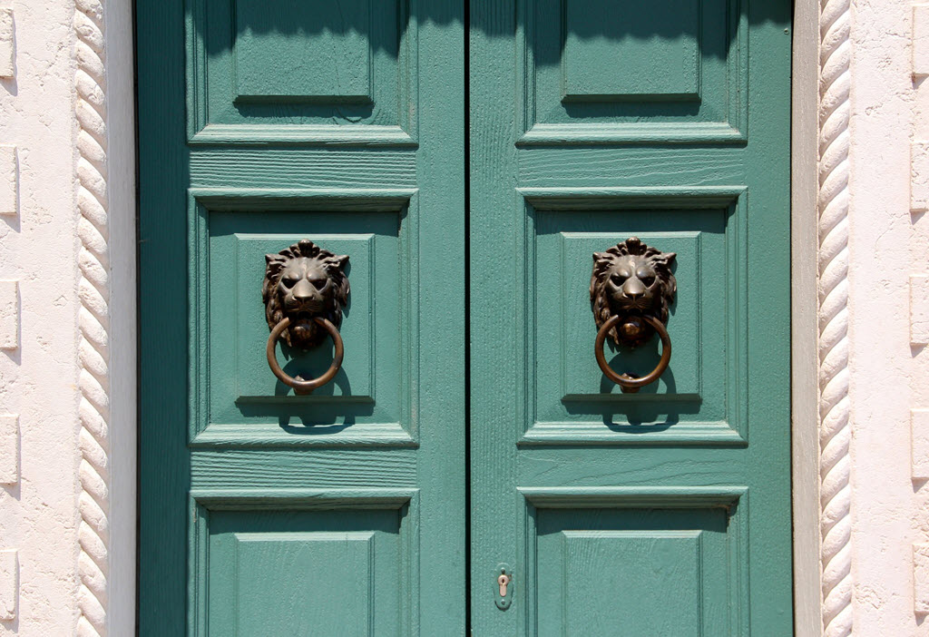 entrance door with lion head door knobs